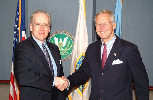 Commodity Futures Trading Commission (CFTC) Chairman Reuben Jeffery III (right) and Federal Energy Regulatory Commission (FERC) Chairman Joseph T. Kelliher shake hands after signing a Memorandum of Understanding regarding the sharing of energy trading information. The agreement fulfills a requirement of the Energy Policy Act of 2005.