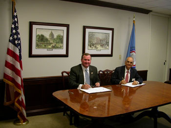 CFTC Chairman James E. Newsome and SEBI Chairman G.N. Bajpai Sign CFTC-SEBI Cooperation Arrangement During a Ceremony at the CFTC's Washington, D.C., Headquarters on April 28, 2004