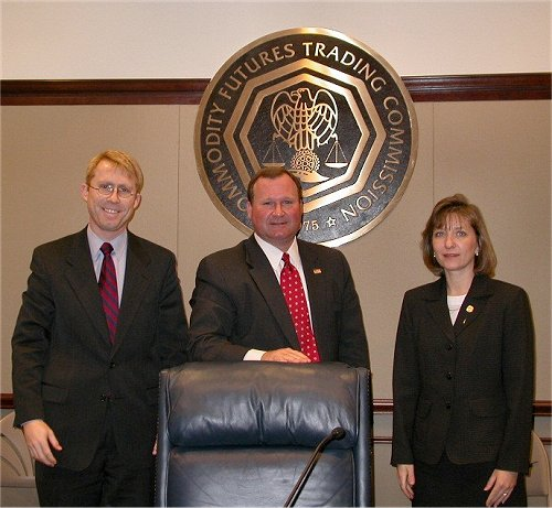 CFTC Chairman James E. Newsome, Commissioner Sharon Brown-Hruska (right), and Commissioner Walter L. Lukken (left) at the Commission's February 4, 2004, Open Meeting at which the U.S. Futures Exchange was designated as a contract market
